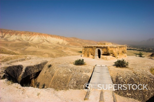 Wooden bridge across chasm leading to Buddhist stupa carved out of rock, Top_I_Rustam Rustam´s throne, an early burial mound that contained Buddha relics dating from the 4th and 5th centuries AD, near Haibak, Samangan Province, Afghanistan, Asia : Stock Photo