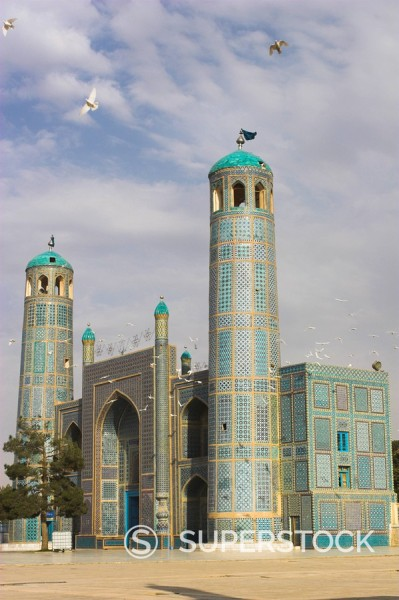 White pigeons fly around the shrine of Hazrat Ali, who was assassinated in 661, Mazar_I_Sharif, Afghanistan, Asia : Stock Photo