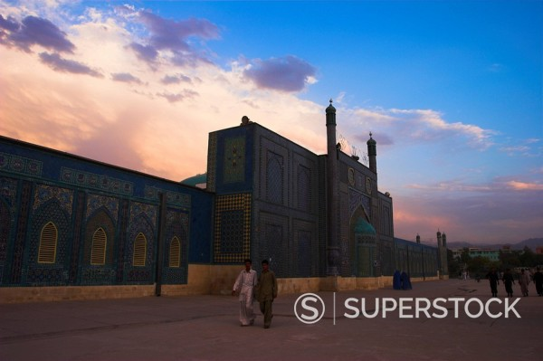 Stock Photo: 1890-16889 People walk at sunset past the Shrine of Hazrat Ali, who was assassinated in 661, Mazar_i_Sharif, Afghanistan, Asia