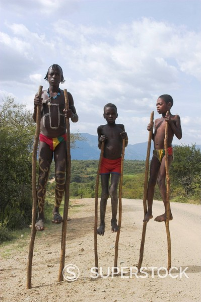 Dorze boys with body painting on stilts, Chencha mountains, Ethiopia, Africa : Stock Photo