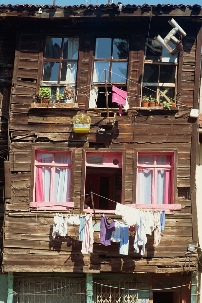 Bird cage and washing lines on the front of a traditional wooden house in the old city of Istanbul, Turkey, Europe : Stock Photo