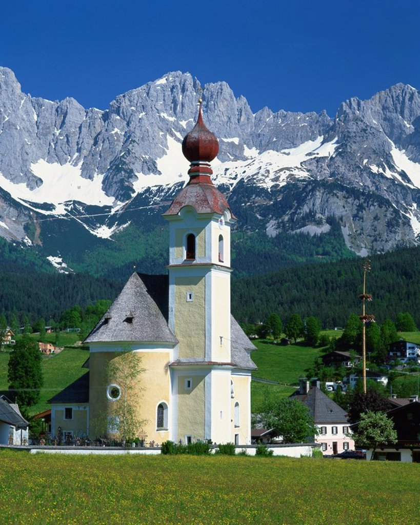 Stock Photo: 1890-18359 Church with onion dome at Going, with mountains behind, in the Tirol, Austria, Europe