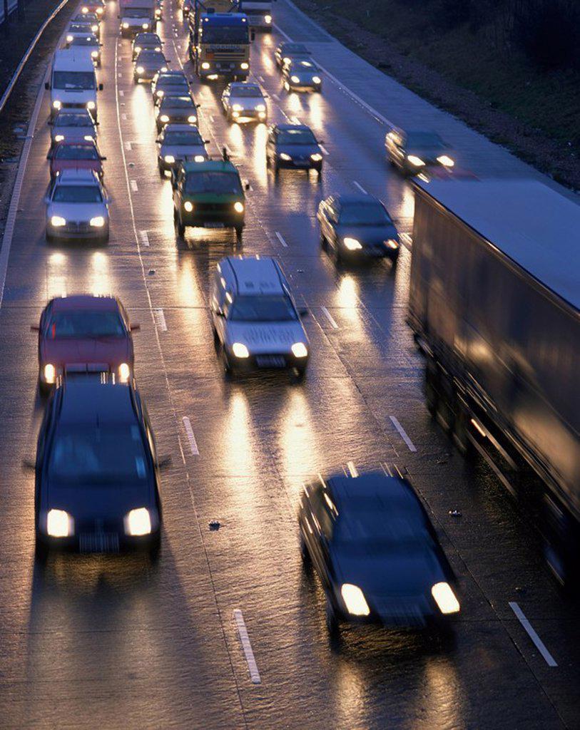 Traffic on wet motorway at dusk, United Kingdom, Europe : Stock Photo