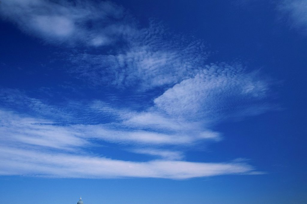 Stock Photo: 1890-21017 Streaks of white clouds in a blue sky