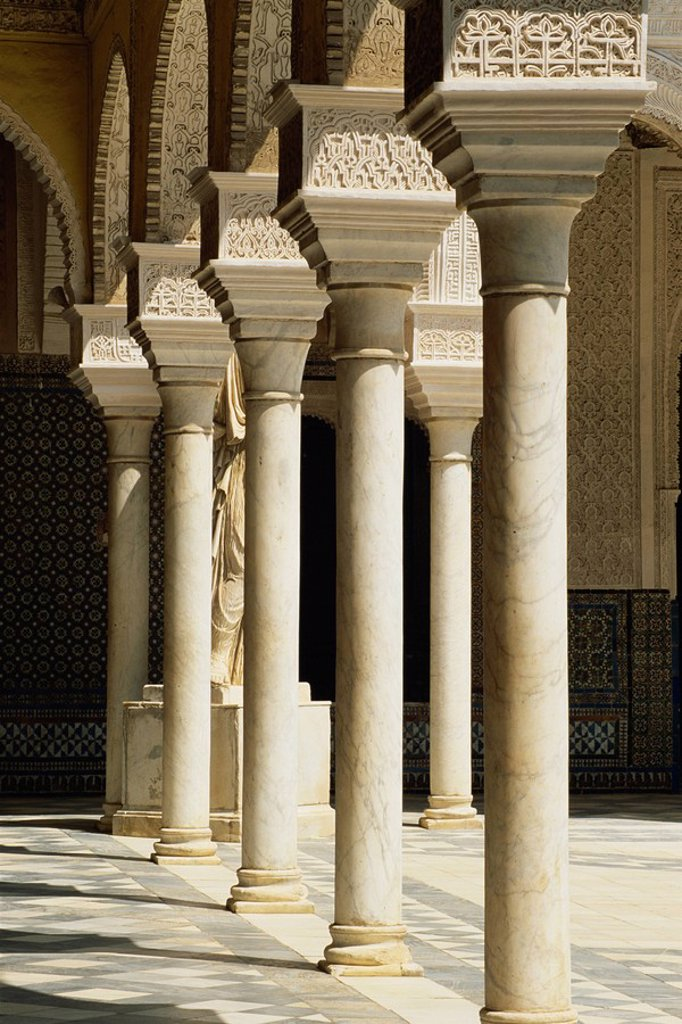 Stock Photo: 1890-21412 Slender pillars of the Patio Principal showing Mudejar carving, Casa de Pilatos, Seville, Andalucia Andalusia, Spain, Europe