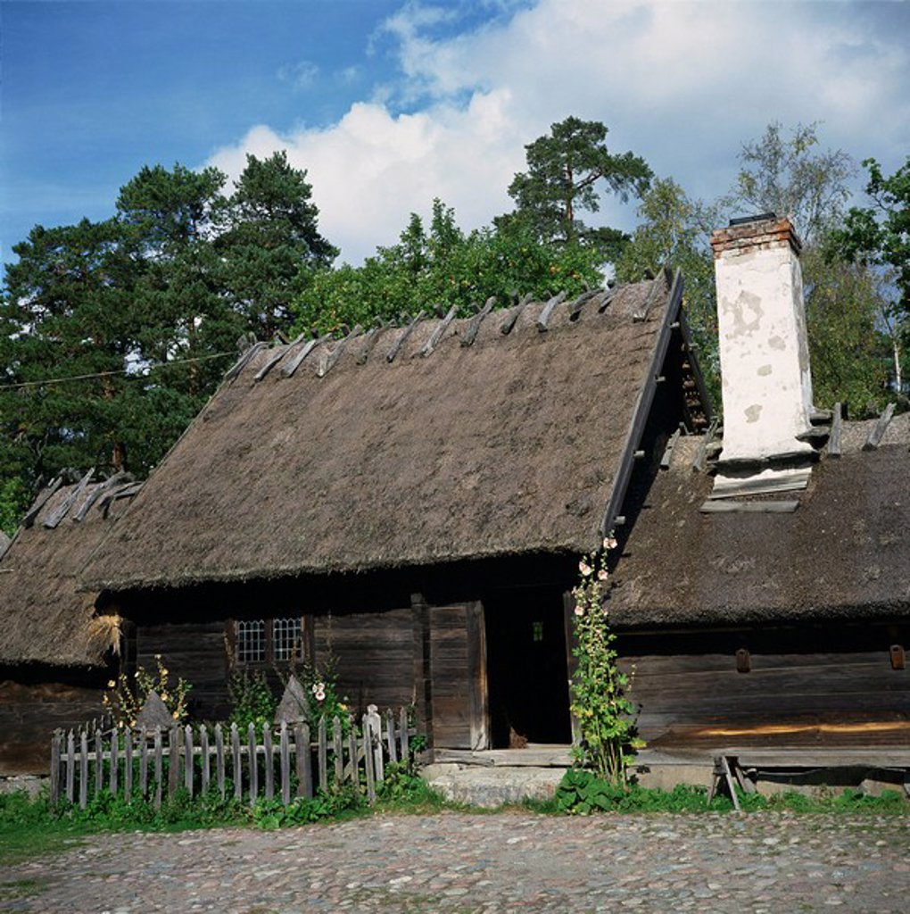 Wooden building with thatched roof of the Oktorp farmstead from Halland, dating from the 18th century, in the Skansen Open Air Museum, in Stockholm, Sweden, Scandinavia, Europe : Stock Photo