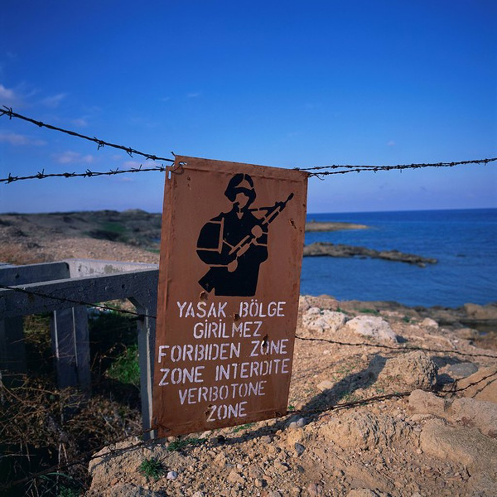 Barbed wire and forbidden zone sign of Turkish Military zone, common following 20 July 1974 invasion, near Lapta, Lambousa, North Cyprus, Europe : Stock Photo