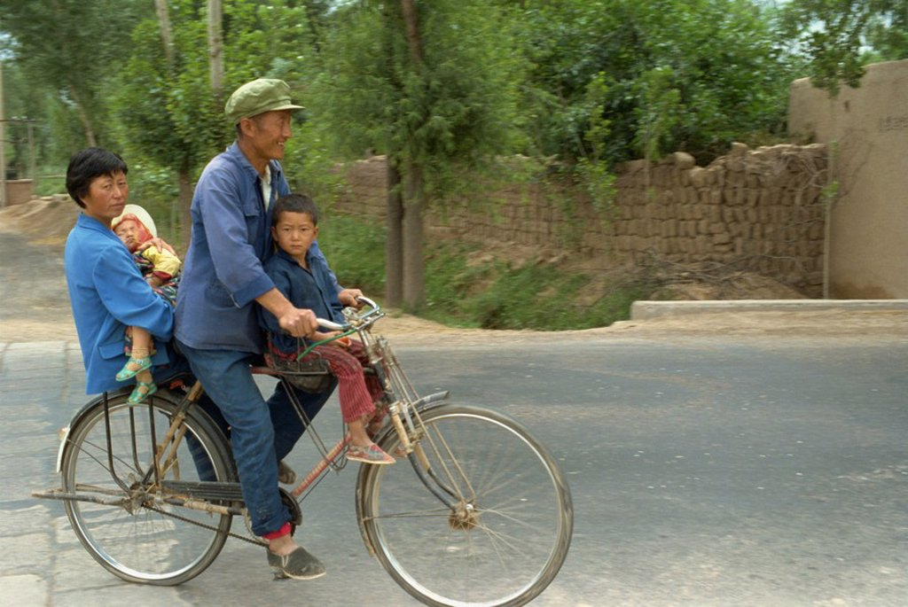Stock Photo: 1890-23081 Family riding on a bicycle in Ningxia, China, Asia