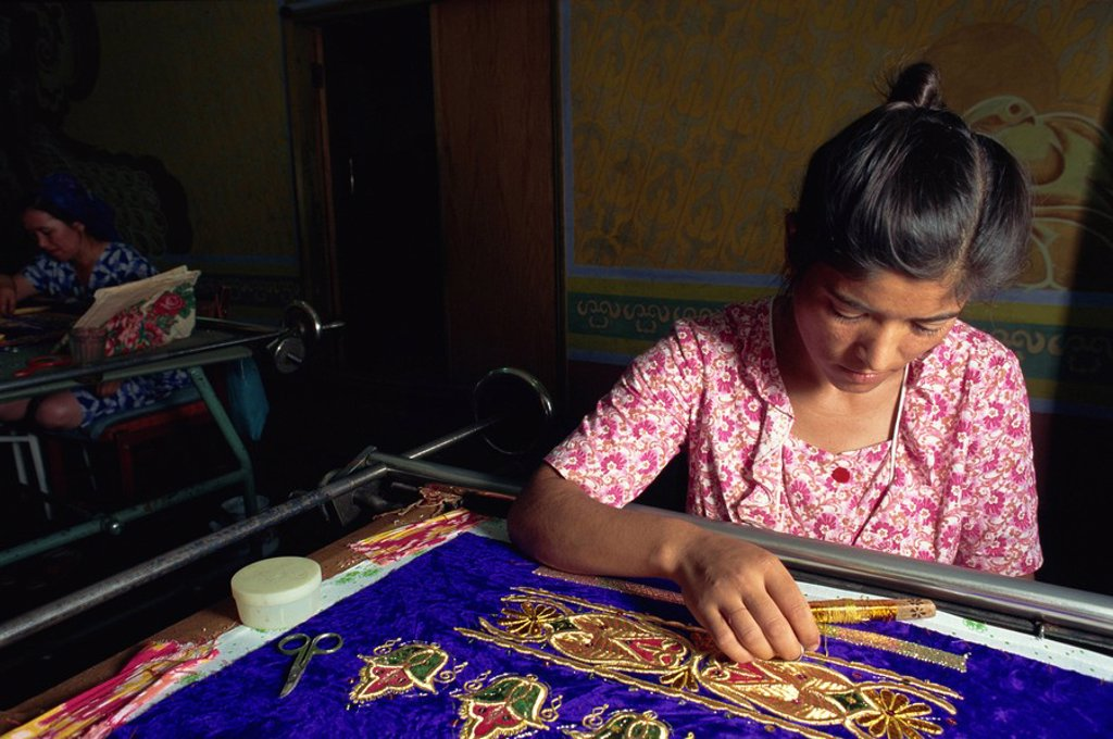 Stock Photo: 1890-23306 Worker in embroidery factory, Bukhara, Uzbekistan, Central Asia, Asia