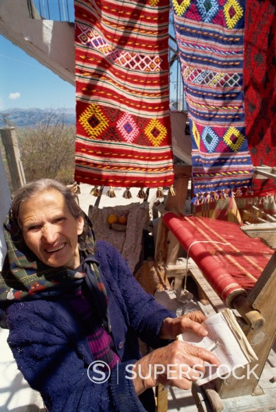 Woman weaver in village near Lasithi Plateau, Crete, Greek Islands, Greece, Europe : Stock Photo
