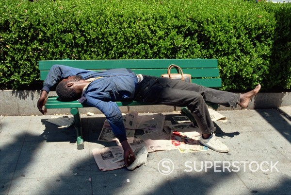 Stock Photo: 1890-2631 Sleeping on bench, Union Square area, San Francisco, California, United States of America, North America