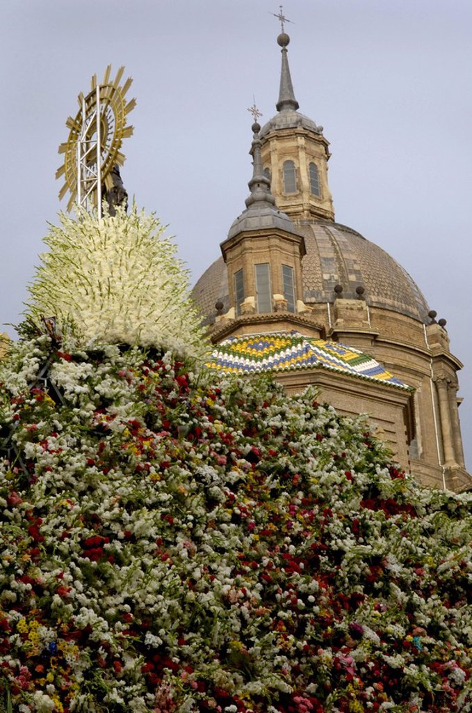 Stock Photo: 1890-26555 The icon of Nuestra Senora del Pilar covered in flowers outside the Basilica during the annual fiesta, Zaragoza, Aragon, Spain, Europe
