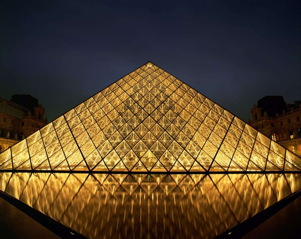 The Pyramide du Louvre illuminated at dusk, Musee du Lourve, Paris, France, Europe : Stock Photo