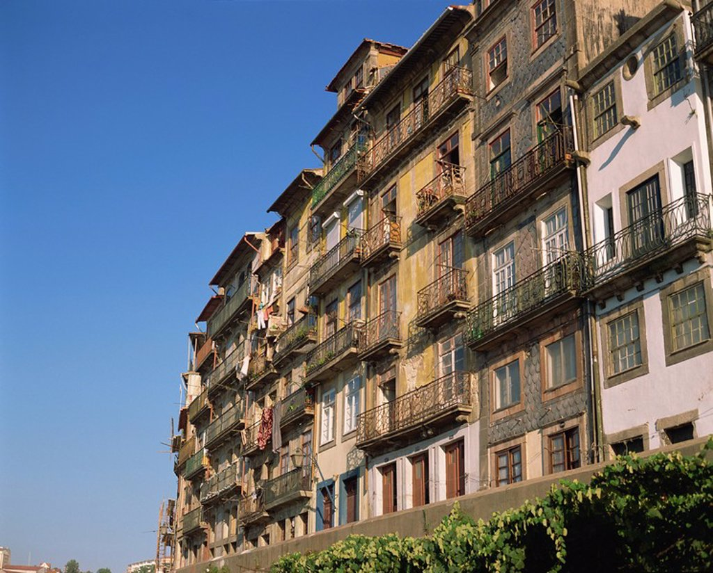 Balconies on the facades of old buildings in the city of Oporto, Portugal, Europe : Stock Photo