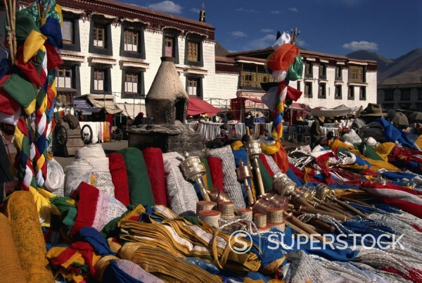 Stock Photo: 1890-28770 Prayer wheels and flags for sale in the Barkor market in Lhasa, Tibet, China, Asia
