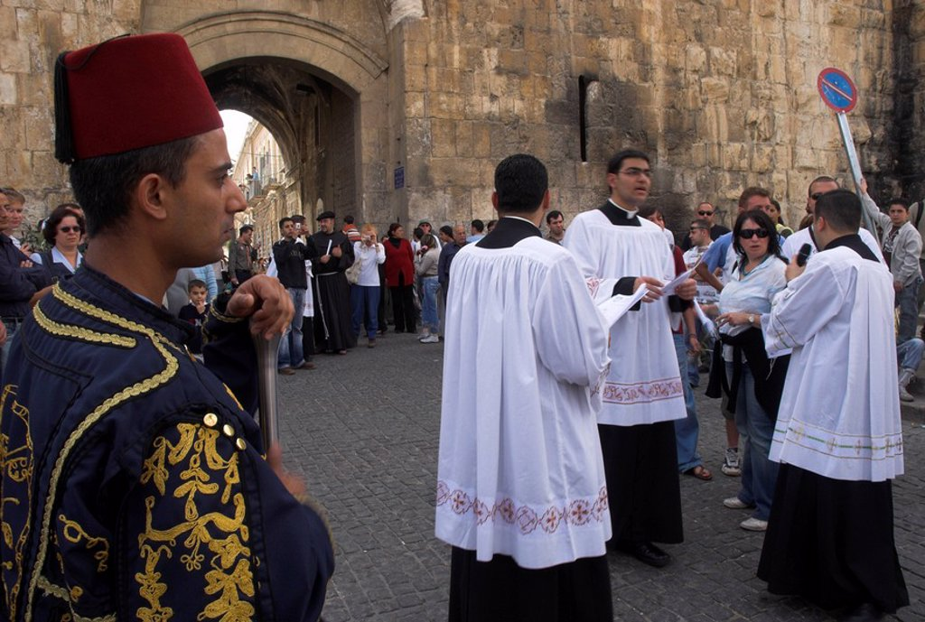 Three Palestinian priests heading the procession at St. Steven´s Gate during Palm Sunday Catholic procession, Old City, Jerusalem, Israel, Middle East : Stock Photo
