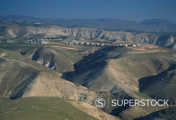 View in winter with typical hills in foreground and Alon settlement beyond, Judean Desert, Israel, Middle East : Stock Photo