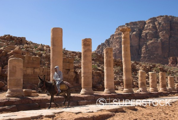 Stock Photo: 1890-29247 Bedouin on a donkey on the colonnaded street, Cardo Maximus, Petra, UNESCO World Heritage Site, Jordan, Middle East