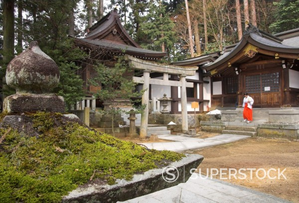 Stock Photo: 1890-29339 Courtyard with temple buildings and female priest wearing traditional red trousers on the stairs, Sakurayama Nikko Kan temple, Takayama, Hida District, Honshu, Japan, Asia