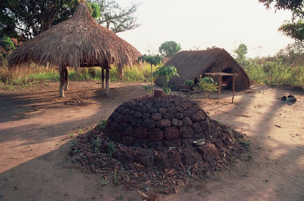 Stock Photo: 1890-30490 Funeral mound next to church in village near Maradi, Sudan, Africa