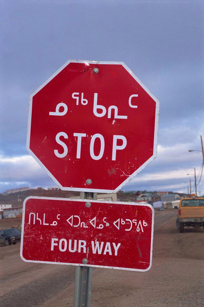 Stock Photo: 1890-30781 Stop sign in Iniktituk language, Iqaluit, Baffin Island, Canadian Arctic,Canada, North America
