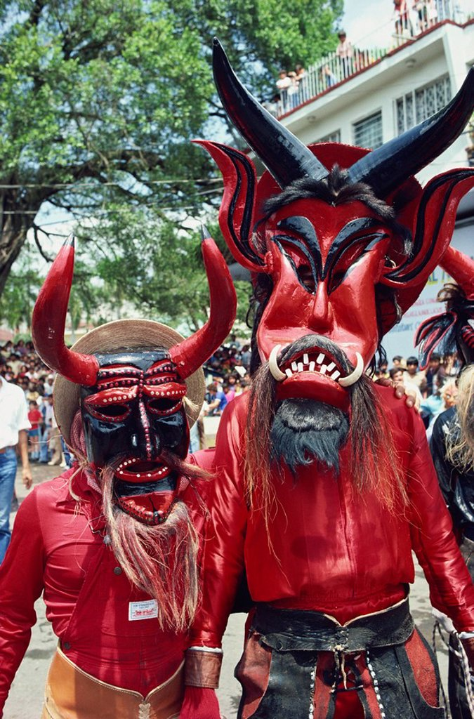Stock Photo: 1890-31471 Portrait of two people with devil masks, wearing red, looking at the camera, during Easter celebrations at Ciudad Santos in Mexico, North America
