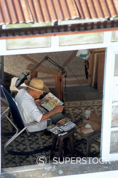 Old man painting, Calla Heridia, Santiago de Cuba, Cuba, West Indies, Central America : Stock Photo