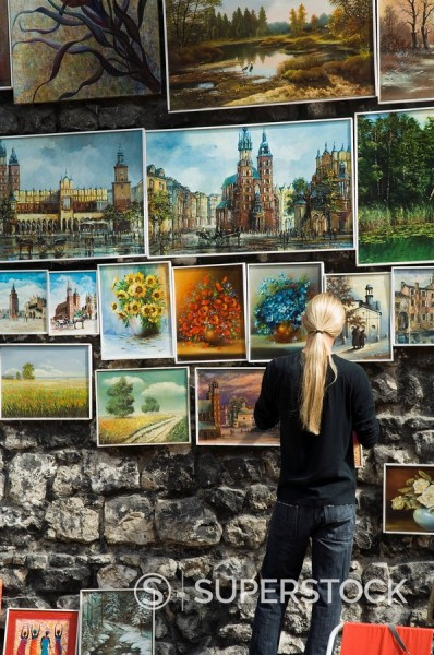 Paintings displayed on the old city walls near Florians´s Gate, Krakow Cracow, Poland, Europe : Stock Photo