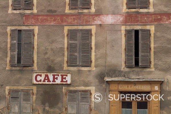 Cafe sign on the outside of an old hotel building with wooden shutters at Mauriac in the Auvergne, France, Europe : Stock Photo
