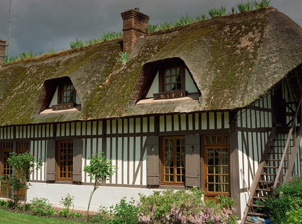 Stock Photo: 1890-39448 Exterior of a traditional timbered and thatched cottage in Vieux Port near Rouen in Haute Normandie Normandy, France, Europe