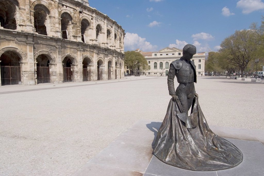 Roman arena with bullfighter statue, Nimes, Languedoc, France, Europe : Stock Photo