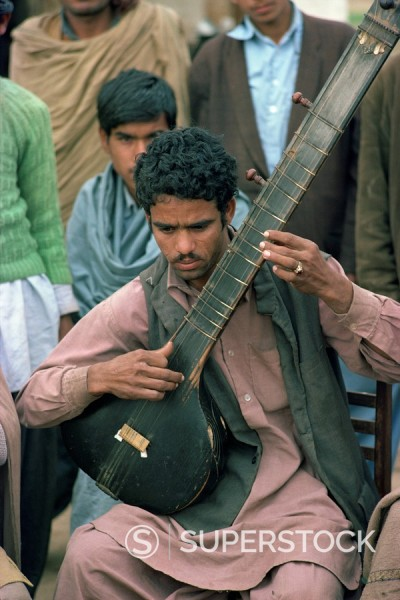 Stock Photo: 1890-4120 Portrait of a musician with his stringed instrument at Alipur village near Rawalpindi, Pakistan, Asia