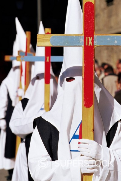 Penitents carrying crosses in procession during Holy Week, Salamanca, Castilla Leon, Spain, Europe : Stock Photo
