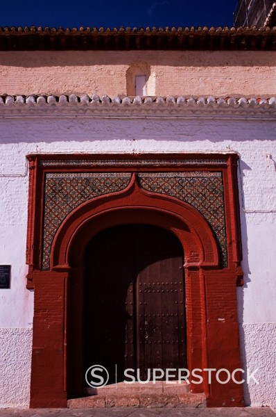 Arched doorway in Mudejar style in the 16th century Iglesia del Nuestra Senora del Rosario, Salobrena, Andalucia, Spain, Europe : Stock Photo