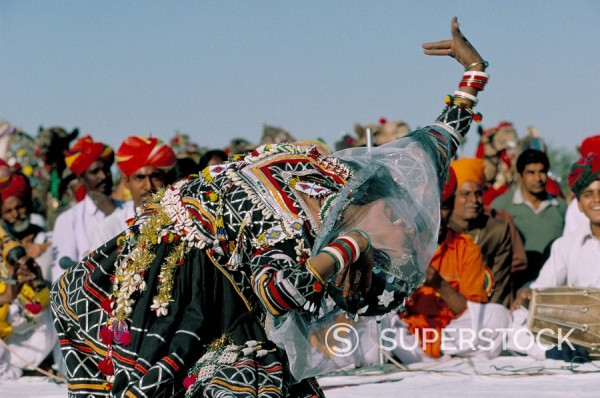 Stock Photo: 1890-43068 Woman dancing during desert festival, Bikaner Desert Festival, Rajasthan state, India, Asia