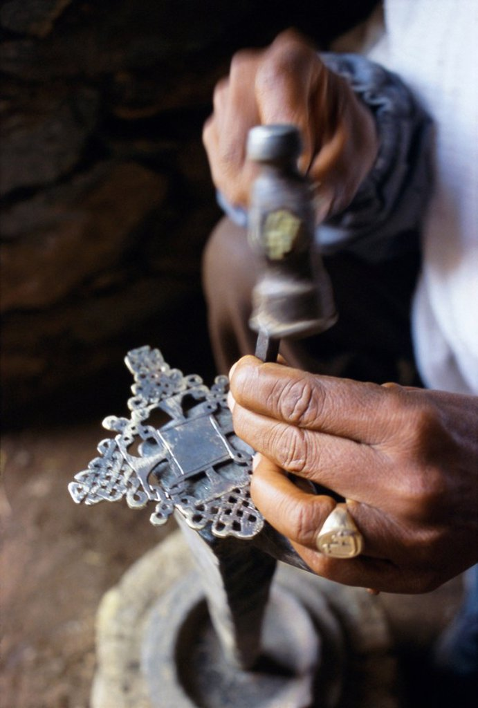 Stock Photo: 1890-44469 Close_up of blacksmith´s hands working on metal cross, Axoum Axum Aksum, Tigre region, Ethiopia, Africa