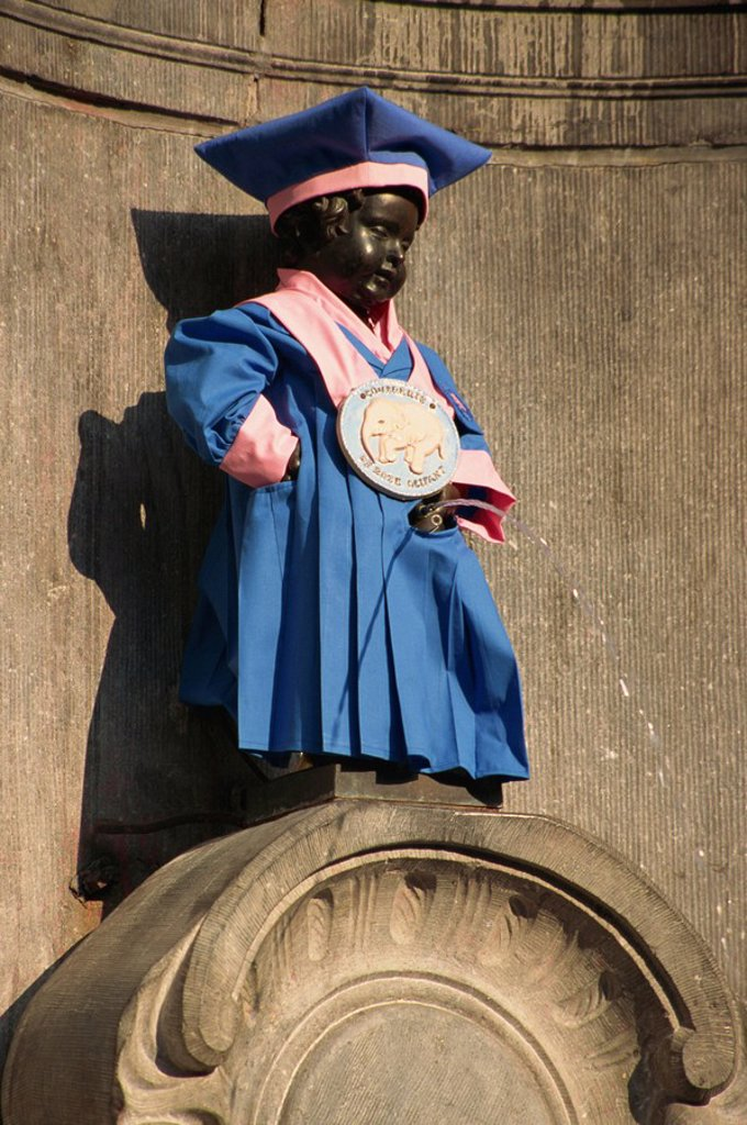 Manneken Pis statue dressed in garb of Brotherhood of Red Elephant, a brewery charity, Brussels, Belgium, Europe : Stock Photo