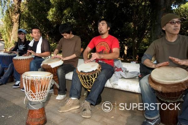 Stock Photo: 1890-47195 Drumming group, Harajuku, Yoyogi koen park, Tokyo, Honshu, Japan, Asia