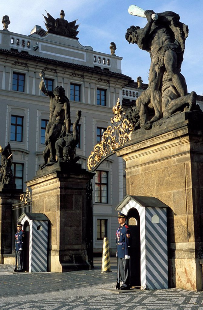 Stock Photo: 1890-47799 Two guards in front of the gate to Prague Castle, which has a titan statue on each of its two pillars, Hradcany, Prague, Czech Republic, Europe