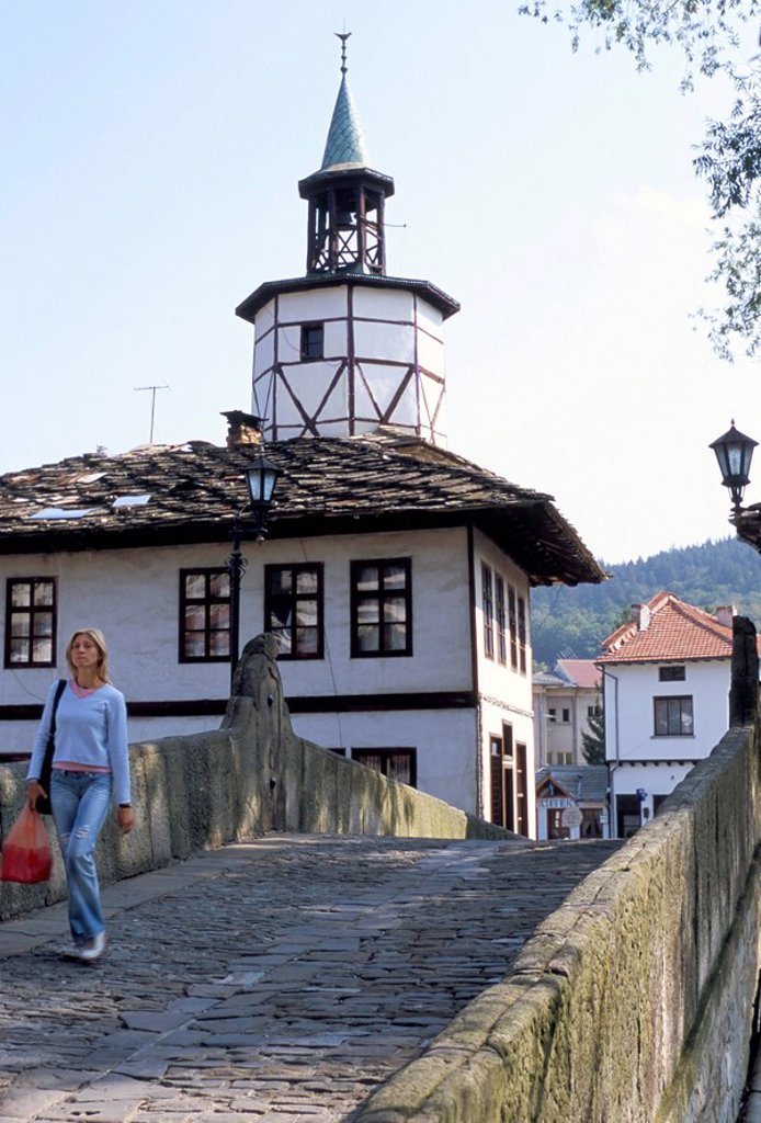 Arch bridge dating from 1844 and traditional house and clock tower in Tryavna old town, Tryavna, Bulgaria, Europe : Stock Photo
