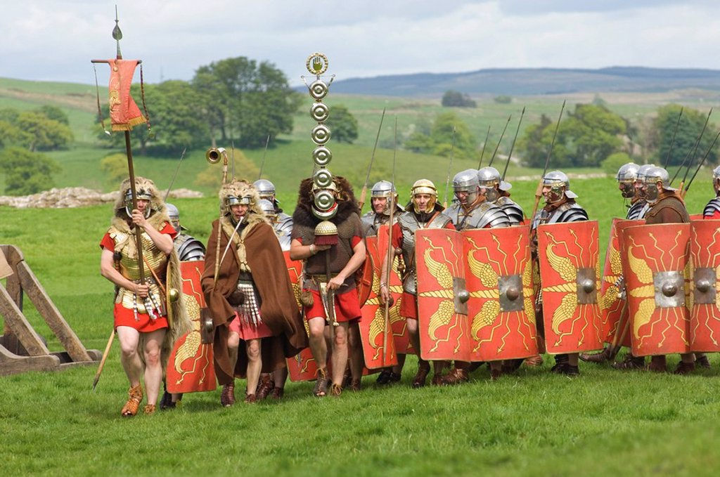 Roman soldiers of the Ermine Street Guard, marching in column led by Standard Bearers and Trumpeter, Birdoswald Roman Fort, Hadrians Wall, Northumbria, England, United Kingdom, Euruope : Stock Photo