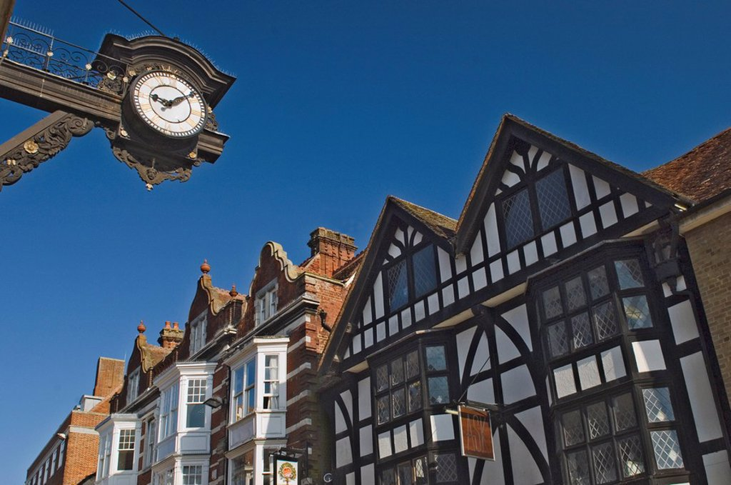 The Bracket Clock and timbered gables, High Street, Winchester, Hampshire, England, United Kingdom, Europe : Stock Photo