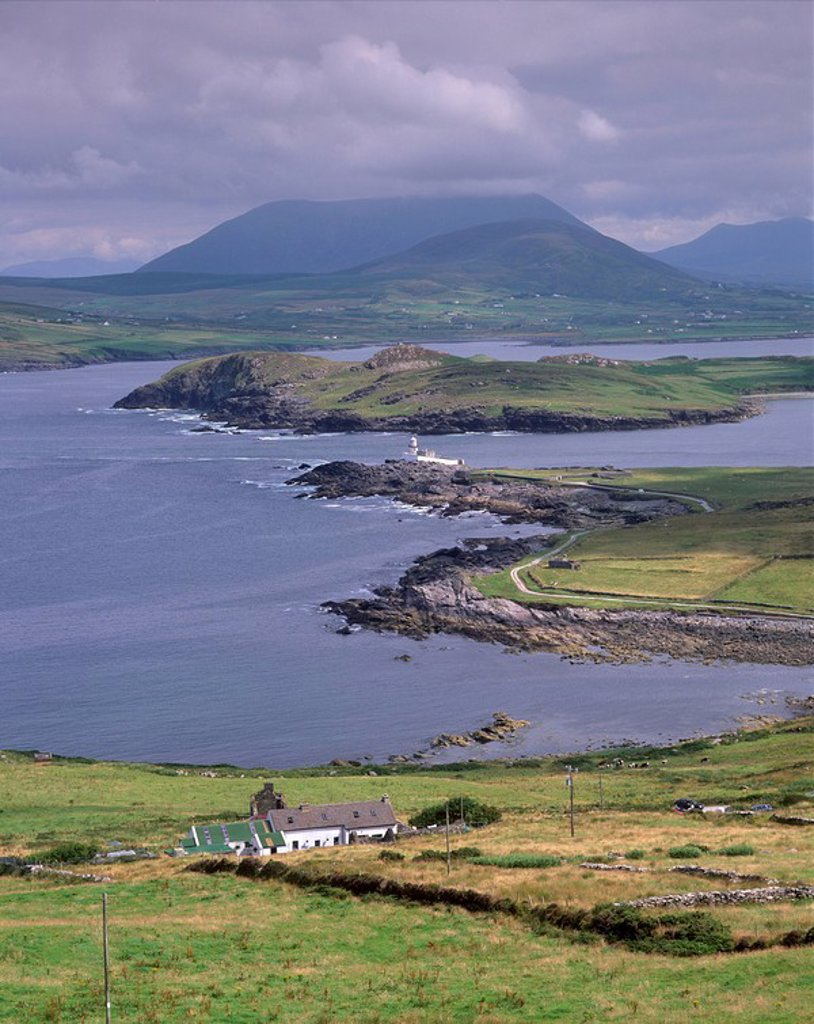 Stock Photo: 1890-55935 Lighthouse, Beginish Island, Doulus Bay and Knocknadobar in the distance, viewed from Valentia island, Ring of Kerry, County Kerry, Munster, Republic of Ireland, Europe