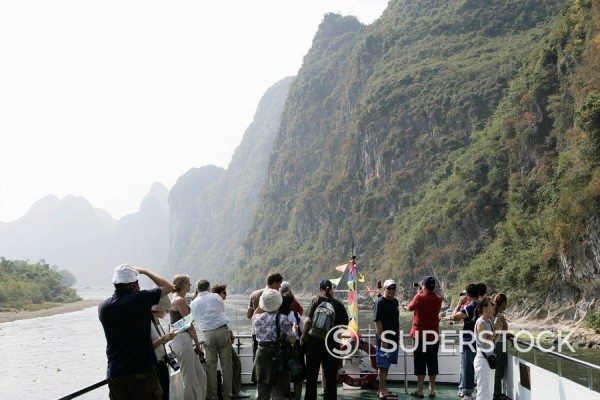 Stock Photo: 1890-57213 Tourists on cruise boat on Li River between Guilin and Yangshuo, Guilin, Guangxi Province, China, Asia