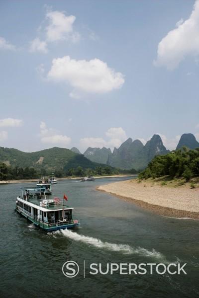 Stock Photo: 1890-57227 Cruise boats on Li River, between Guilin and Yangshuo, Guilin, Guangxi Province, China, Asia