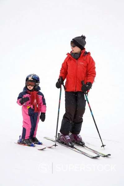 Stock Photo: 1890-59027 Mother teaching child to ski, Arapahoe Basin Ski Resort, Rocky Mountains, Colorado, United States of America