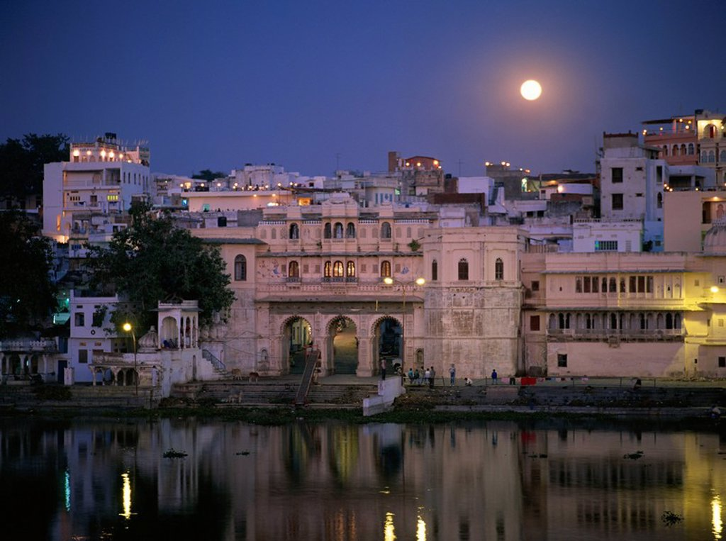 Stock Photo: 1890-6076 Moonlit view of Gangaur Ghat, with old city gateway, Udaipur, Rajasthan state, India, Asia