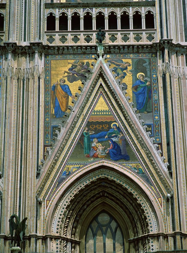Mosaics, mostly 18th and 19th century replacements of originals, on facade of cathedral, Orvieto, Umbria, Italy, Europe : Stock Photo