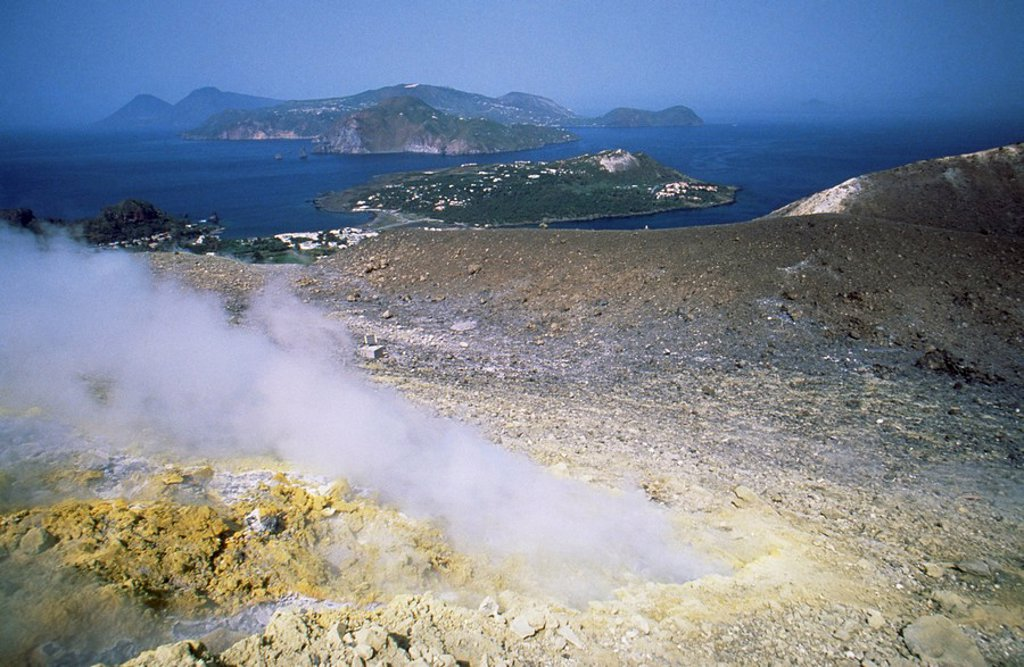 Stock Photo: 1890-61376 Steam issuing from sulphurous fumarole at Gran Craters, Vulcano Island, with islands of Lipari and Salina beyond, Aeolian Islands Eolian Islands Lipari Islands, UNESCO World Heritage Site, Sicily, Italy, Mediterranean, Europe