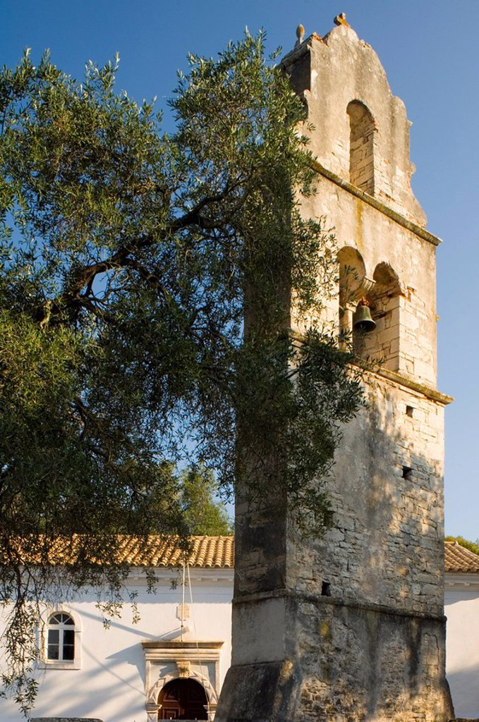 The stone belltower of Agios Constantinos in an olive tree grove, Paxos, Ionian Islands, Greek Islands, Greece, Europe : Stock Photo